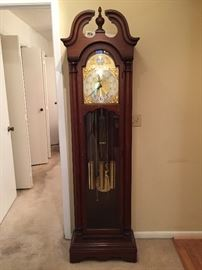 Working Colonial grandfather clock, approximately 30 years old.