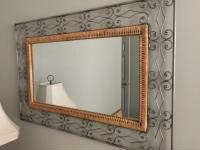 Metal and wicker framed mirror