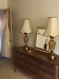 Master Bedroom - Walnut credenza and vintage preserved wedding dress
