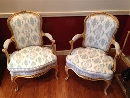 A pair of 19th-century French gilt-wood fauteuil armchairs.