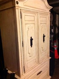 Armoire features built-in drawers, shelves, mirror and lots of storage!