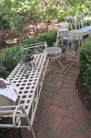 lots of exterior metal furniture, tables and fern stands