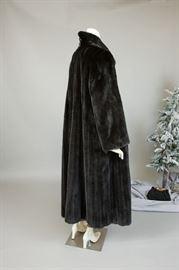 Georgous opera length black gamma mink coat from Mouratidis Furs. Generous swing. Lush pelts.