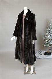 Black gamma opera length coat.