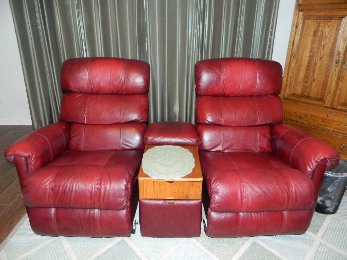 Two (2) sets of these great red leather reclining chairs with matching tables!