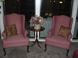 Wing back chairs and antique pedestal table.