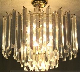 "Mid-Century Lucite 3-tier Chandelier (21""W X 15""D) View with lights on."