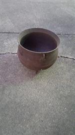 Old black iron pot