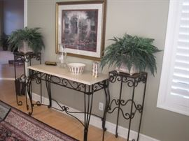 Plant stands. Plants. Art work. Lenox china. Console Table.