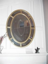 Oval mirror with beveled glass panels and center mirror