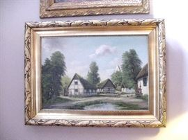 Oil on canvas of thatched roof houses surrounding a pond