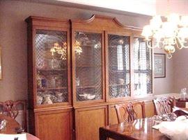 Fabulous breakfront with four glass door across the front and solid wood door below