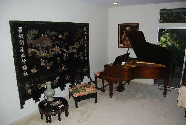 baby grand Mathushek piano, antique Chinese tables and screen
