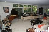 living room with baby grand, antique Chinese screen, antique Chinese ceramics & pottery
