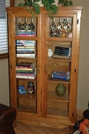 Lighted curio bookcase with leaded glass windows