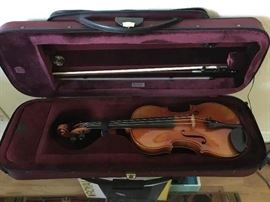 Fine violin by Rudolf Buchner of Germany dated 1961with maple back & neck & spruce top in Stradivarius-style in very good condition. The vintage bow of the early 1900s, also in very good condition, by Adolf Schuster of Germany, made of pernambuco with ebony, silver, mother of pearl & ivory tip;  like-new shoulder rest & zippered, padded case