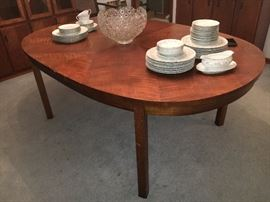 "Mid Century ""Founders"" walnut dining table. Matching lighted china/curio cabinet and rolling expandable server/bar also available."