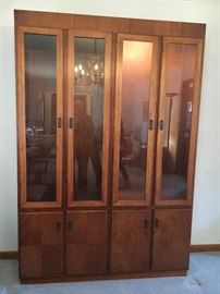 "Mid Century ""Founders"" lighted walnut china/curio cabinet--glass shelves and doors above with solid doors, shelves and drawers below. Oval dining table and rolling server/bar also available."