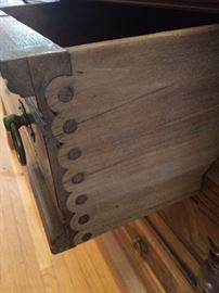 Side of drawer of antique China hutch. Knapp joint woodwork used from 1871 to 1900.  Amazing!!