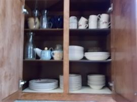 Assorted kitchenwares, everyday china, glassware, cookware.