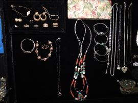 Native American necklace and several gold pieces of jewelry