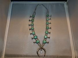 Sterling and Turquoise Squash Blossom necklace attributed to the early Tsosie family.