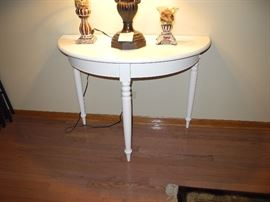 Half moon painted white table