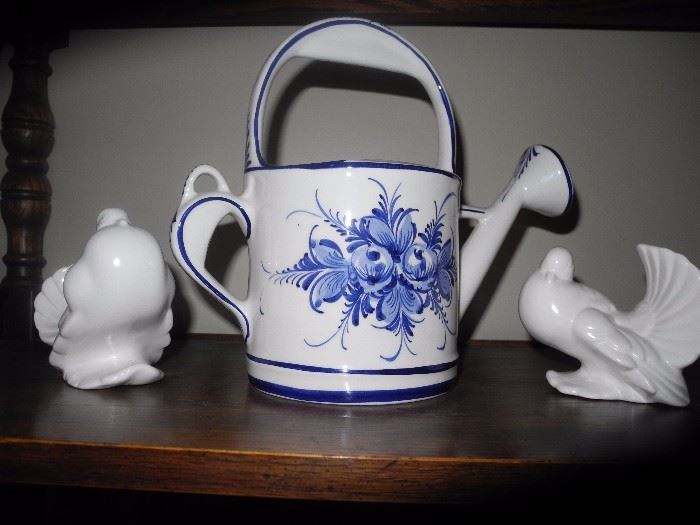 Ceramic watering can and birds