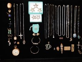 14K white and Yellow Gold, Tiffany and Co and .925 Chains, a .999 one ounce silver bar and misc charms.