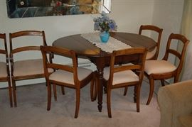 Drop leaf dining table with 6 chairs and 2 leafs (leafs not pictured)!