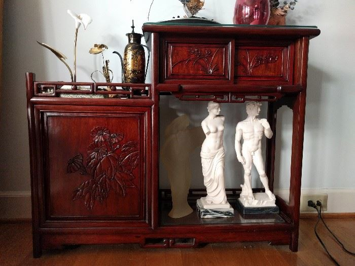 Whoa, my eyes, my eyes! Frontal nudity in cultured marble! Oh, those cheeky Italians! All displayed on a hijacked Asian design asymmetrical cabinet.