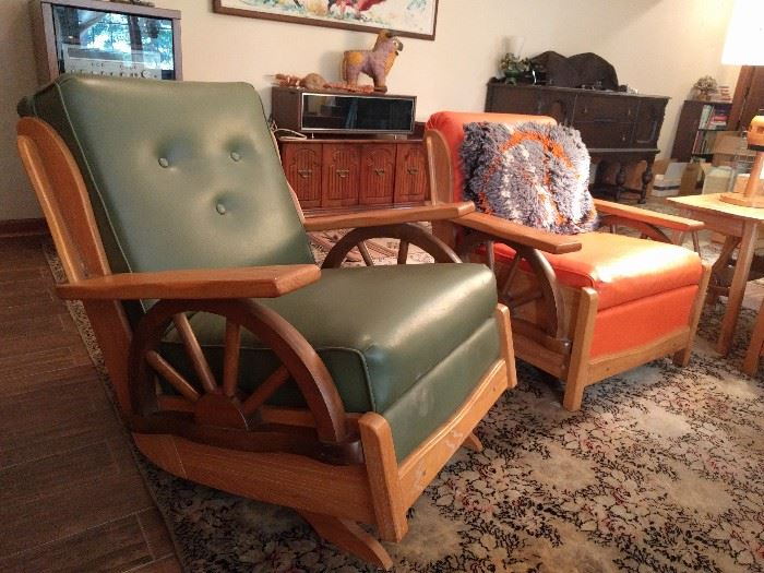 For the Man and Lady of the house, there's a manly green naugahyde rocker and a sensible burnt orange stationary chair, for quiet evenings at home, around the fireplace, knitting and reading.