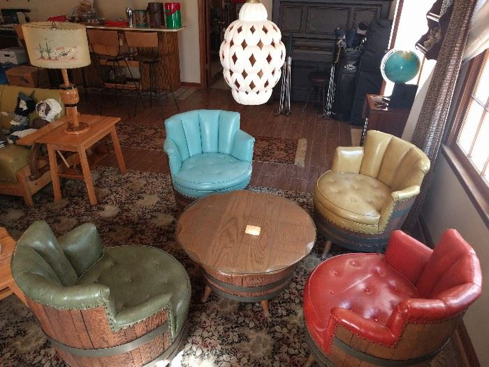 WOW! What a find! A complete set of 1960's yippee-yi- yo barrel furniture, by the San Hygene Furniture Mfg. Co., Akron, OH.                                                                  There's even a postage stamp sticker on the tag, stating Commonwealth of PA, Dept. of Labor and Industry, Harrisburg.                                                     Where in the world would you ever find a swivel barrel chair, each in the hottest earth tone naugahyde colors available? The glass-topped barrel coffee table is also a lazy susan.                                                                        You gotta hand it to those Texans for coming up with such a design jewel.                                                                  Dig the hanging, opium den pendant lamp!