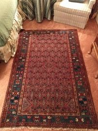 "Distinctly different Persian Malayer, 100% wool, hand woven, measures 4' 3"" x 6' 3""."
