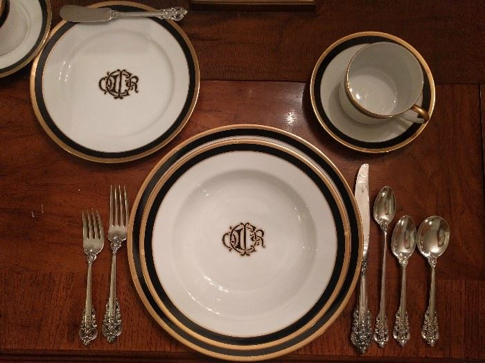 "Here's a pic of the Christian Dior ""Monogram Black"" place setting, with a wonderful paring of Grand Baroque sterling flatware.                                                There's a huge set of the flatware, a combination of Mother's and Grandmother's set. You should see the serving pieces!                                                                            The weight makes them useful for family food fights or when the peaceful dinner conversation turns to politics..."