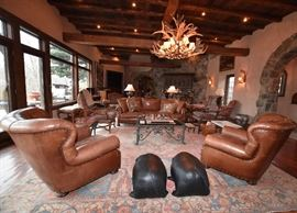 Ralph Lauren Brown Leather Chairs, Leather Pig Foot Stools, Antler Chandelier