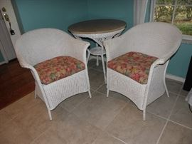 Old wicker chairs, old wicker table with marble top