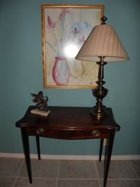 Mahogany serpentine front table, brass lamp, brass cast sculpture, watercolor