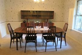 MCM Rosewood Table and (6) Chairs.  Chairs are Koefoeds Homslet with original black vinyl fabric.