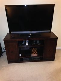 One of 2 flat screen t.v.'s and a base with storage!
