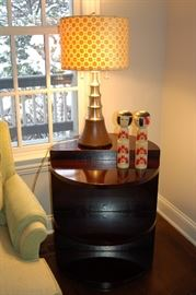 Round end table with shelves, contemporary lamp and asian deco