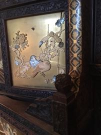 Inlay panels and intricate wood carving details with gold lacquer designs