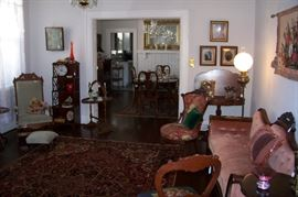 A view of the living room - showing a beautiful oriental rug, Victorian sofa, chairs, etc.