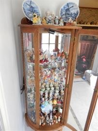 CURVED,LIGHTED CURIO CABINET FILLED WITH KURT ADLER HERSHEY CHARACTERS, ETC.