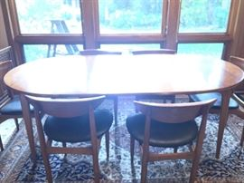 mid-century table with 6 chairs and leaves