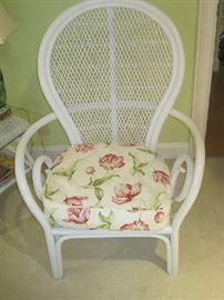 White wicker chair with cushion matching bedspread fabric