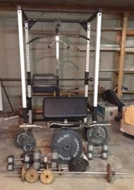 Tuff Stuff Weight Rack and Home Gym, 2- 45lb Wt, 2- 35lb Wt, 4- 10lb Wt, 4- 25lb Wt, 6- 5lb Wt, 2- 2lb Wt, 2 Barbells, 1 Curling Bar, 2- 35lb Dumbbells, 2- 40lb Dumbbells, 2- 20lb Dumbbells