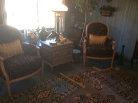 2 MATCHING PROVENCIAL CHAIRS ATOP WOOL RUGS