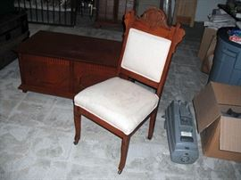 Victorian parlor chair; trunk coffee table; Electrolux vacuum cleaner