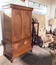 Exquisite oak media armoire made by Lexington, collection of miniature rockers, recliner